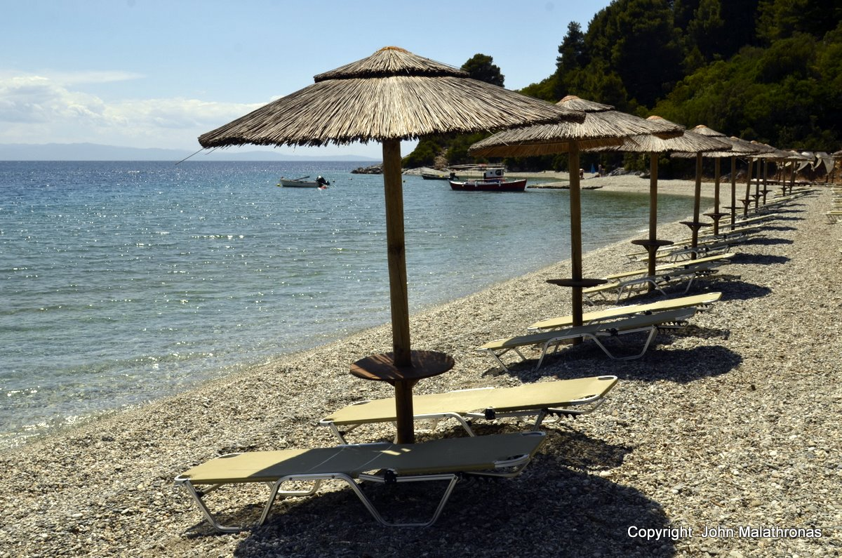 Panormos Beach - the umbrellas await